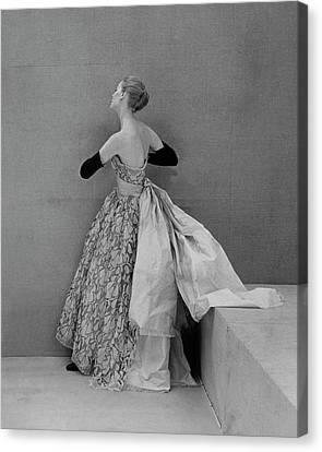 A Model Wearing An Evening Gown Canvas Print by Henry Clarke
