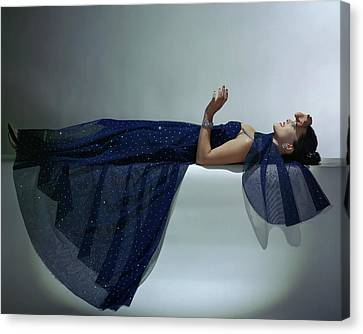 A Model Wearing An Evening Gown Canvas Print by John Rawlings