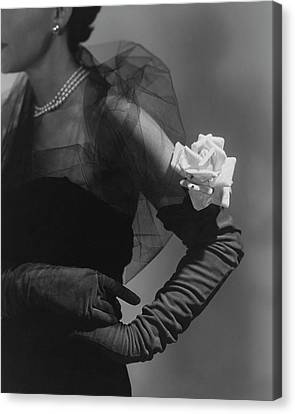 A Model Wearing And Velvet Rose Canvas Print by Horst P. Horst