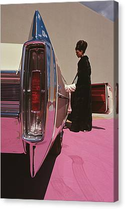 Dark Pink Canvas Print - A Model Wearing Emeric Partos Entering A 1965 by Gene Laurents