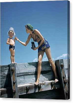 A Mother And Son On A Pier Canvas Print by Toni Frissell
