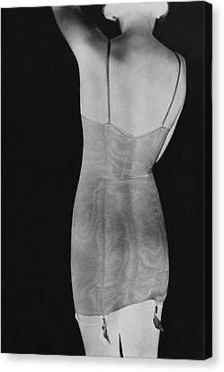 Corset Canvas Print - A Negative Print Of A Woman Wearing A Corset by George Hoyningen-Huene