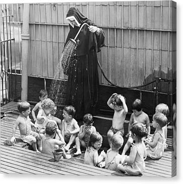 A Nun Watering Children Canvas Print by Underwood Archives