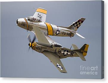 A P-51 Mustang And F-86 Sabre Canvas Print by Rob Edgcumbe