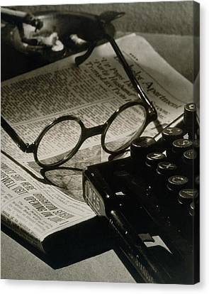 A Pair Of Glasses On Top Of A Newspaper Canvas Print by Irving Browning
