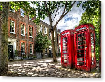 Canvas Print featuring the photograph A Pair Of Red Phone Booths by Tim Stanley