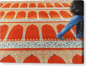 A Person Walking Over The Colourful Canvas Print by Keith Levit