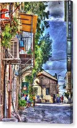 A Picturesque Street Canvas Print by Uri Baruch