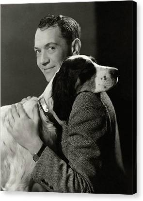 A Portrait Of John Held Jr. Hugging A Dog Canvas Print by Nicholas Muray