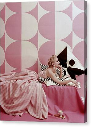 Leaning Canvas Print - A Portrait Of Lisa Fonssagrives Lying by Richard Rutledge