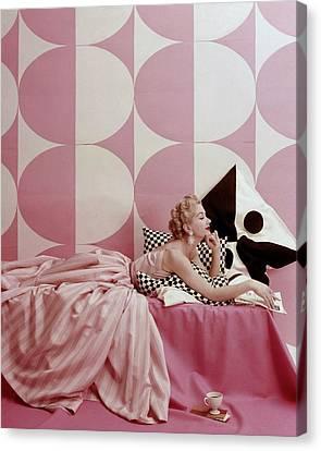 Pink Hair Canvas Print - A Portrait Of Lisa Fonssagrives Lying by Richard Rutledge