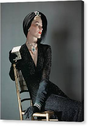A Portrait Of Lisa Fonssagrives Sitting Canvas Print by Horst P. Horst