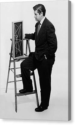 A Portrait Of Paul Mccobb Leaning On A Ladder Canvas Print by Herbert Matter