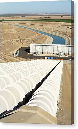 A Pumping Station Sends Water Uphill Canvas Print by Ashley Cooper