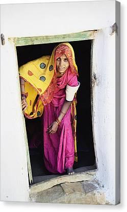 A Rajput Woman Leaving A Building Near Canvas Print