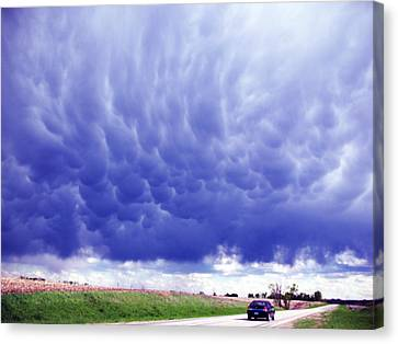 Canvas Print featuring the photograph A Rural Nebraska Highway And Magnificent Sky by Tyler Robbins