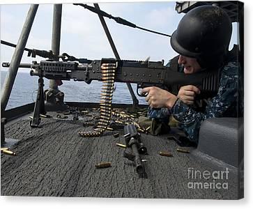 A Sailor Fires An M-240b Machine Gun Canvas Print by Stocktrek Images