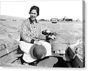 A Solo Woman In A Motor Boat Canvas Print by Underwood Archives