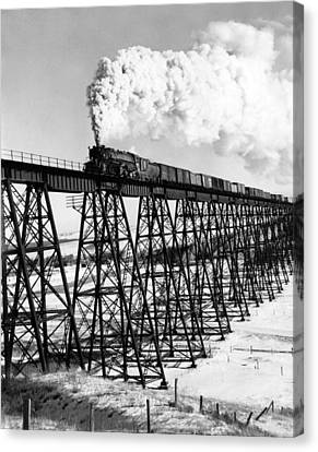 A Steam Engine On Trestle Canvas Print