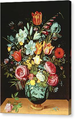 A Still Life Of Flowers In A Porcelain Vase Resting On A Ledge Canvas Print by Phillipe de Marlier