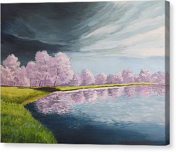 A Storm Over Cherry Trees Canvas Print by Wanda Dansereau