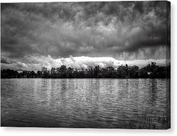 A Storm Rolls By Canvas Print by Thomas Young