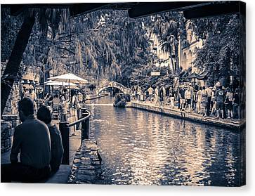 A Stroll On The Riverwalk Canvas Print by David Morefield