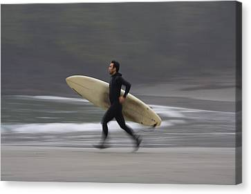 A Surfer Running To The Water With His Canvas Print