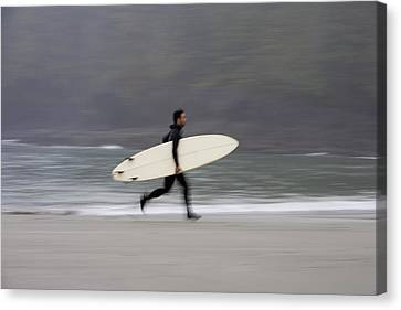 A Surfer, Running With Board Along The Canvas Print