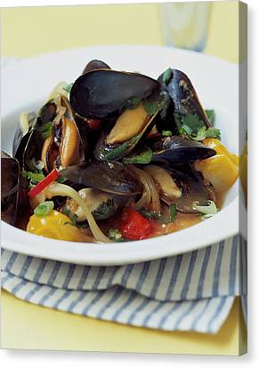A Thai Dish Of Mussels And Papaya Canvas Print by Romulo Yanes