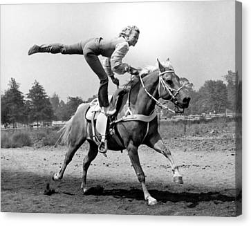 A Trickriding Cowgirl Canvas Print by Underwood Archives