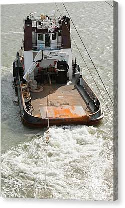 A Tug Boat Towing A Jack Up Barge Canvas Print