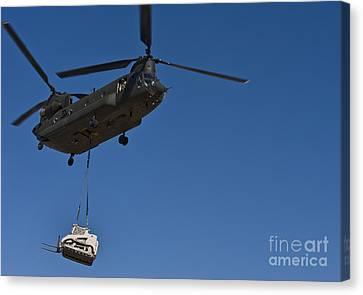 A U.s. Army Ch-47 Chinook Carries Canvas Print by Stocktrek Images