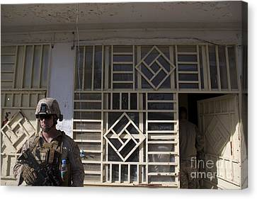 A U.s. Marine Provides Security Canvas Print by Stocktrek Images