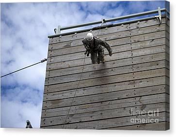 A U.s. Soldier Runs Down A 40-foot Canvas Print by Stocktrek Images