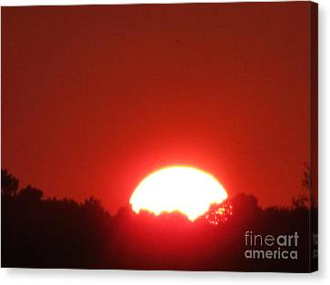 Canvas Print featuring the photograph A Very Hot Sunset by Tina M Wenger