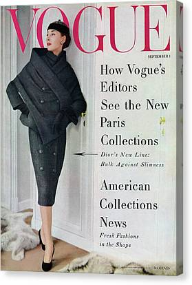 Dior Canvas Print - A Vogue Cover Of A Model Wearing A Dior Suit by Henry Clarke