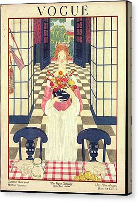 A Vogue Cover Of A Woman Holding Flowers Canvas Print by George Wolfe Plank