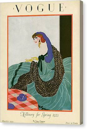 A Vogue Cover Of A Woman Putting On Gloves Canvas Print by Helen Dryden