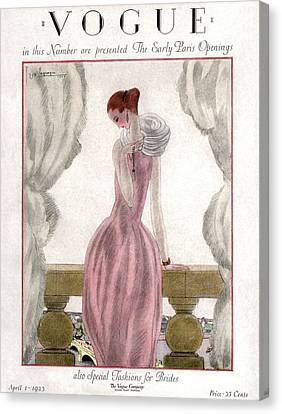 A Vogue Cover Of A Woman Wearing A Pink Dress Canvas Print by Georges Lepape