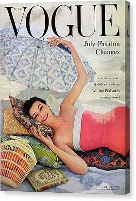 Writing Canvas Print - A Vogue Cover Of Anne Gunning Under An Umbrella by Karen Radkai