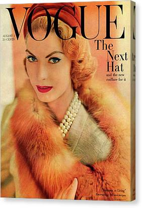 A Vogue Cover Of Mary Mclaughlin Wearing A Fox Canvas Print by Horst P. Horst
