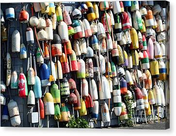 A Wall Of Bouys Canvas Print by Rosemary Aubut