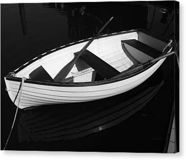 A White Rowboat Canvas Print by Xueling Zou