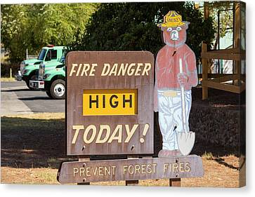 A Wildfire Danger Sign In Springville Canvas Print by Ashley Cooper