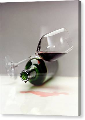 A Wine Bottle And A Glass Of Wine Canvas Print by Romulo Yanes