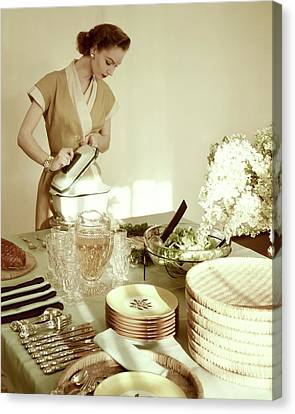 A Woman At A Dining Table Canvas Print by Haanel Cassidy