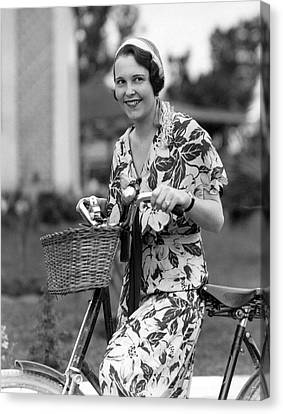 A Woman On A Bicycle Canvas Print