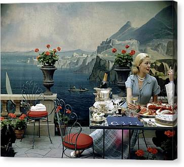 A Woman Sitting At A Dining Table In Front Canvas Print by John Rawlings