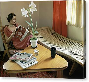 A Woman Sitting By A Coffee Table And Chaise Canvas Print